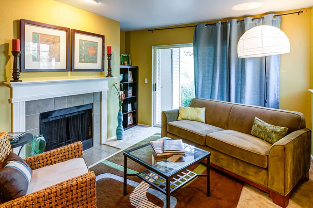 Living room with fireplace at Walden Pond Apartments in Everett, Washington
