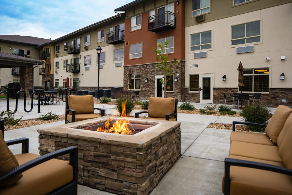 Seating surrounding the Affinity at Loveland fire pit