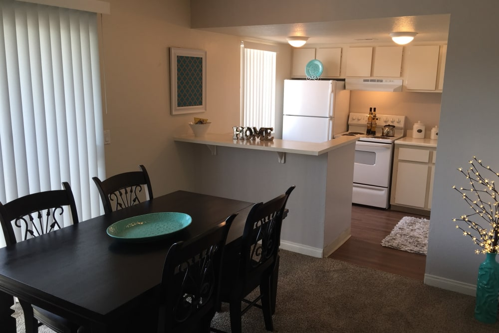 A dining area and kitchen layout at Lantana Apartments