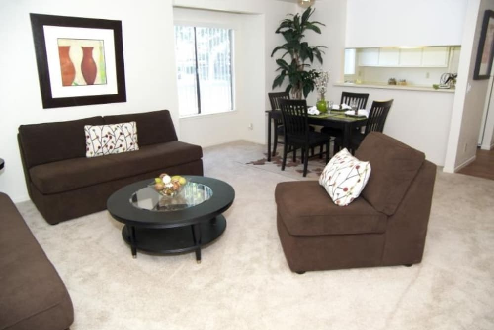 Bright and spacious living room at Waterfield Square Apartment Homes