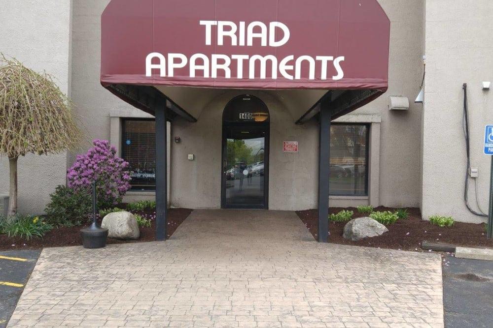 Triad Apartments Sign