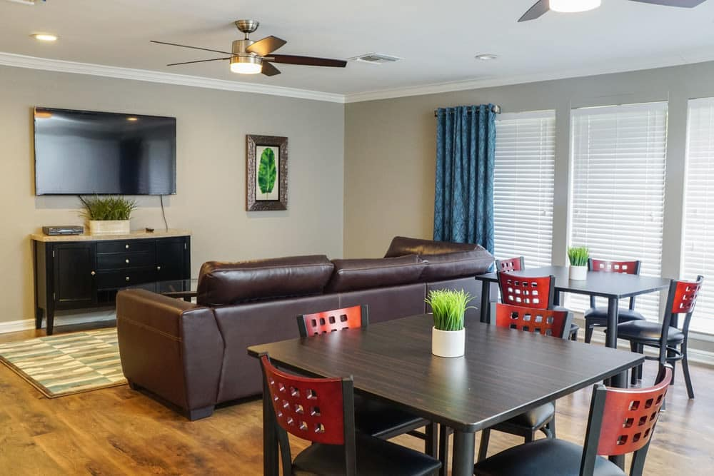 Living and dining area at The Abbey at Medical Center in San Antonio