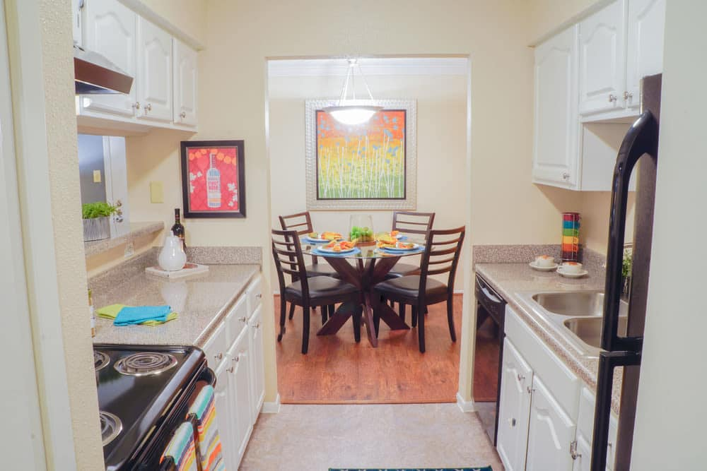 A view of the kitchen inside apartments at The Abbey at Medical Center