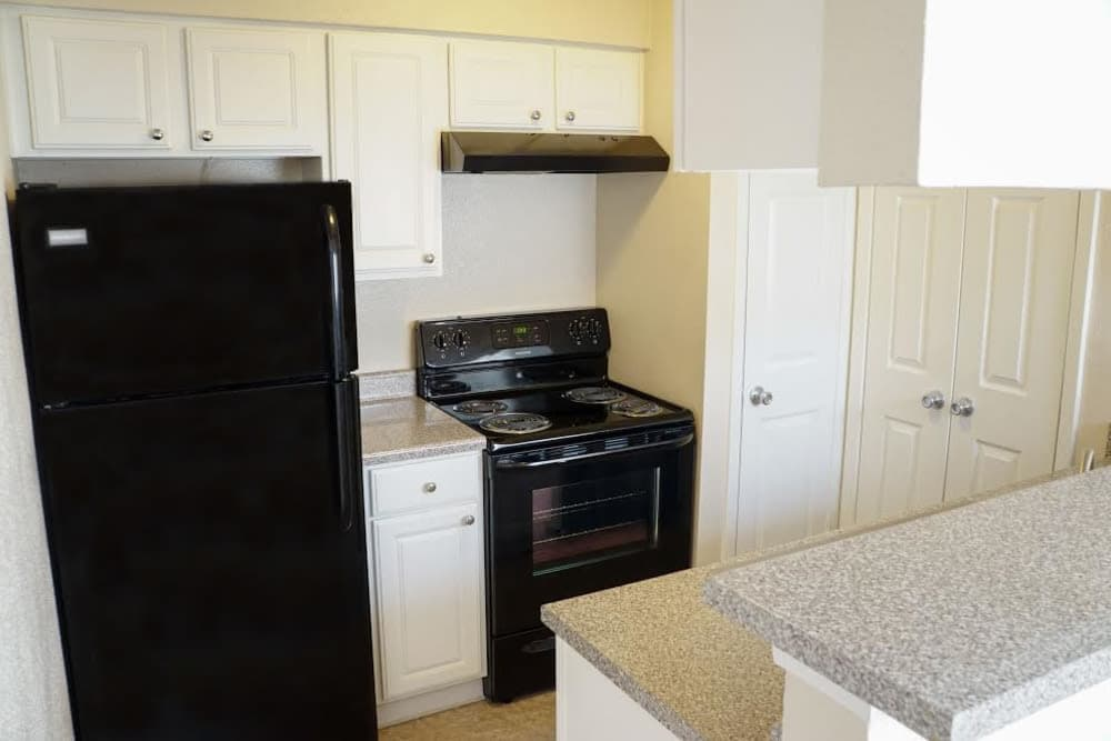 Kitchen with black appliances at The Abbey at Medical Center