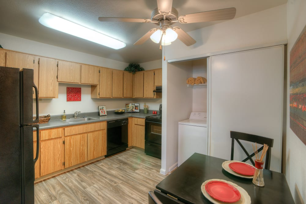 Fully-equipped kitchen and dining table view at Argenta Apartment Homes