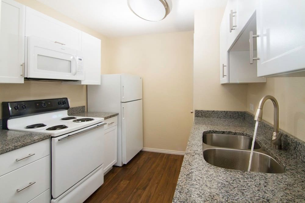 Well lit kitchen at Woodgate Apartments
