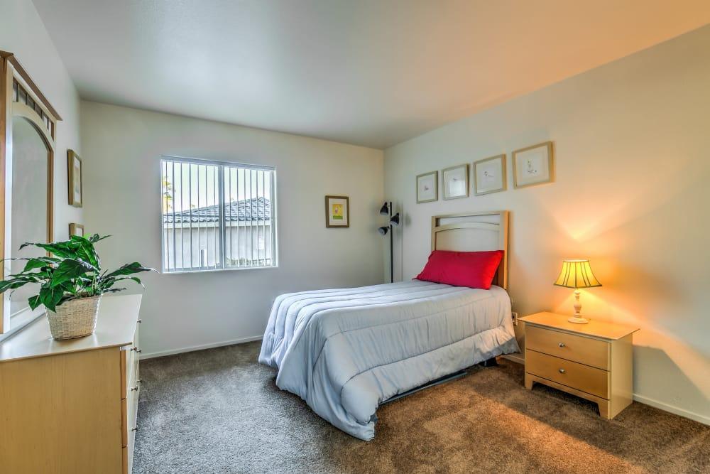 Well lit bedroom at Portofino Villas Apartments