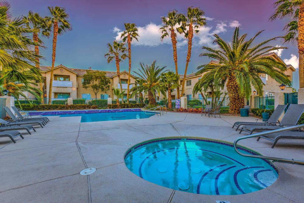 Swimming pool at hot tub at Portofino Villas Apartments