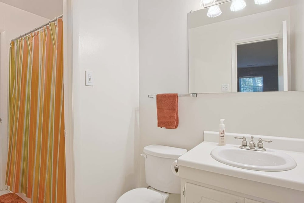 Model bathroom in apartment home at Woods of Williamsburg Apartments