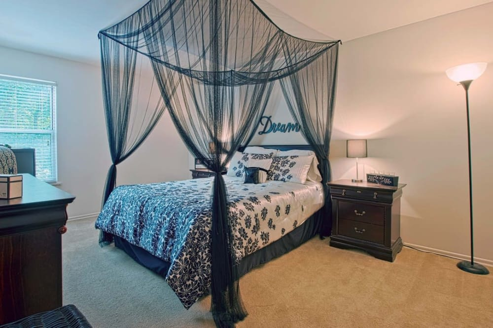 Well-decorated model bedroom at Woods of Williamsburg Apartments