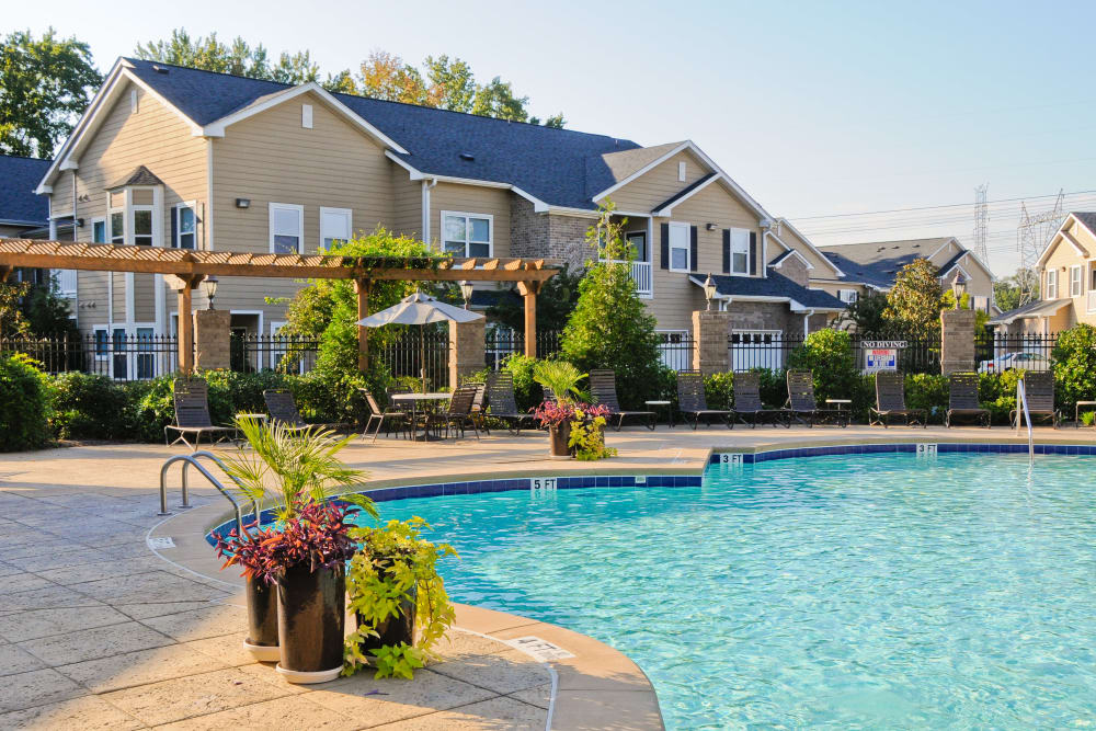 Relax by the pool at Villas at Houston Levee West Apartments in Cordova, TN