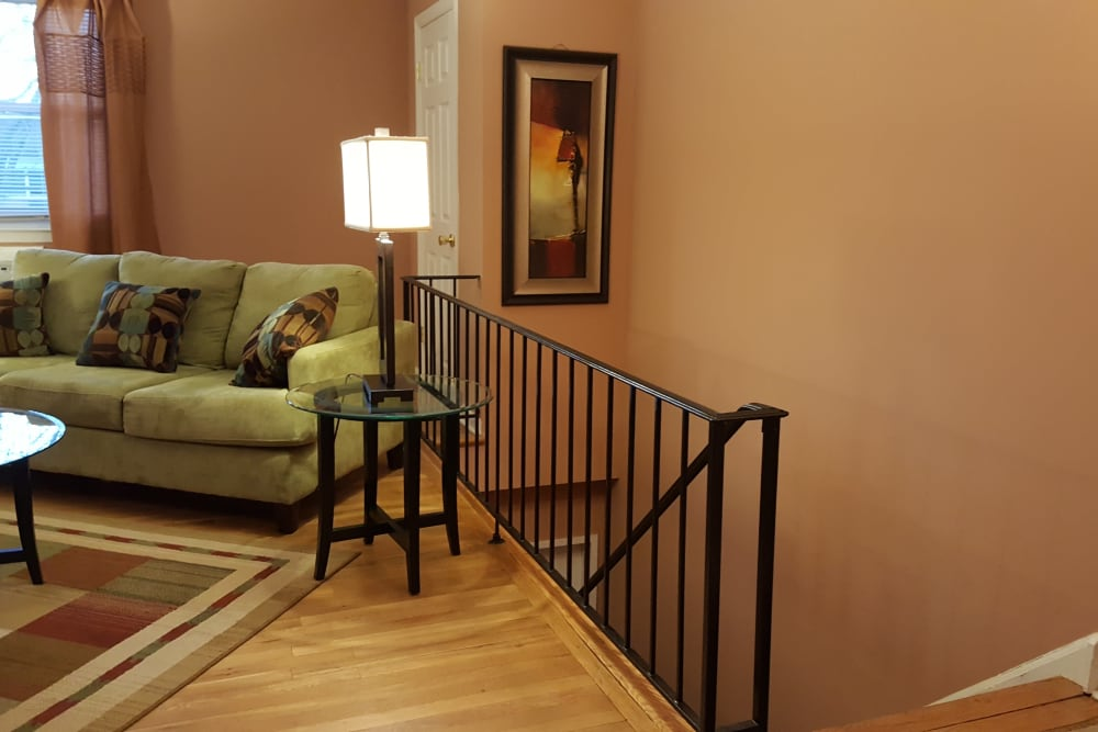 Stairs leading up to living area in model home at Wingate Apartments