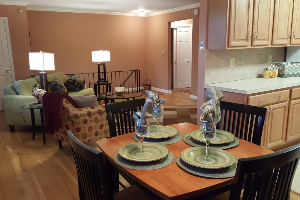 View of dining area with living room in background in model apartment home at Wingate Apartments