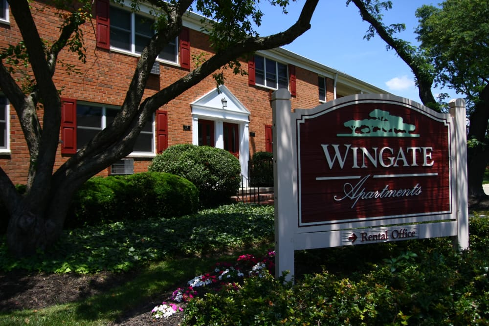 Closer view of our sign and leasing office exterior at Wingate Apartments