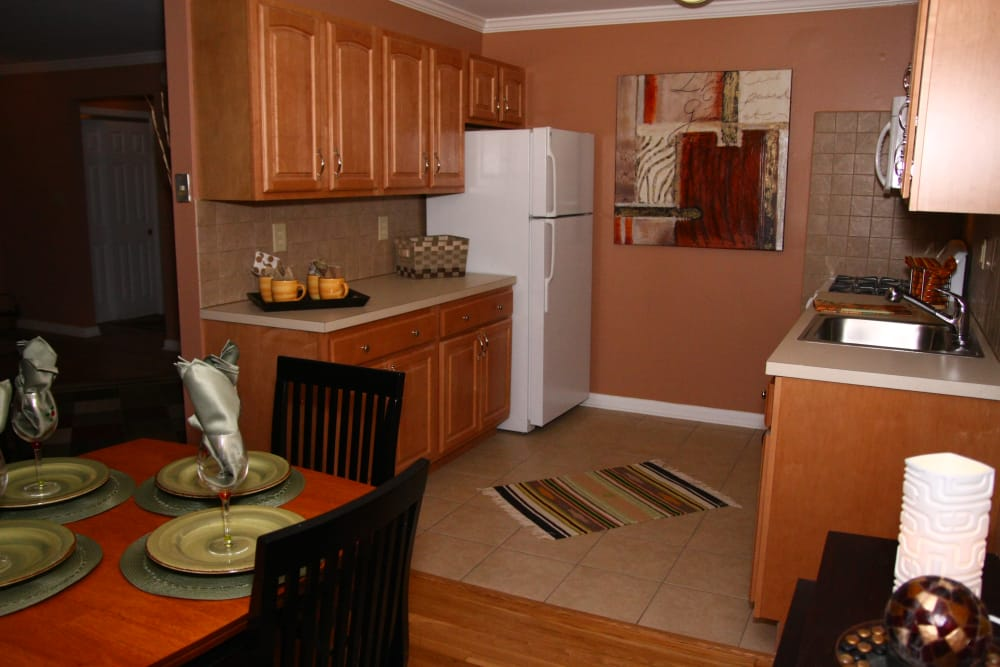 Kitchen view from the dining area in model home at Wingate Apartments