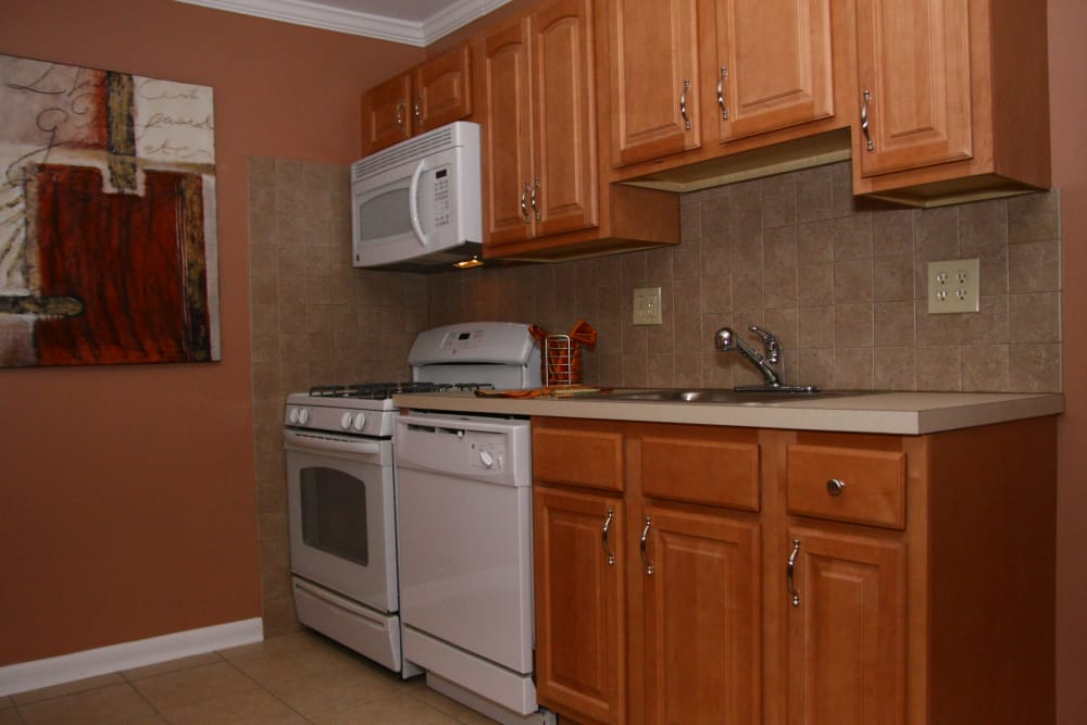 Modern kitchen in model home at Wingate Apartments