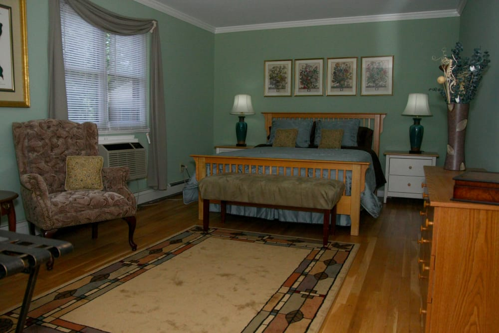 Large and well-decorated bedroom in model home at Wingate Apartments