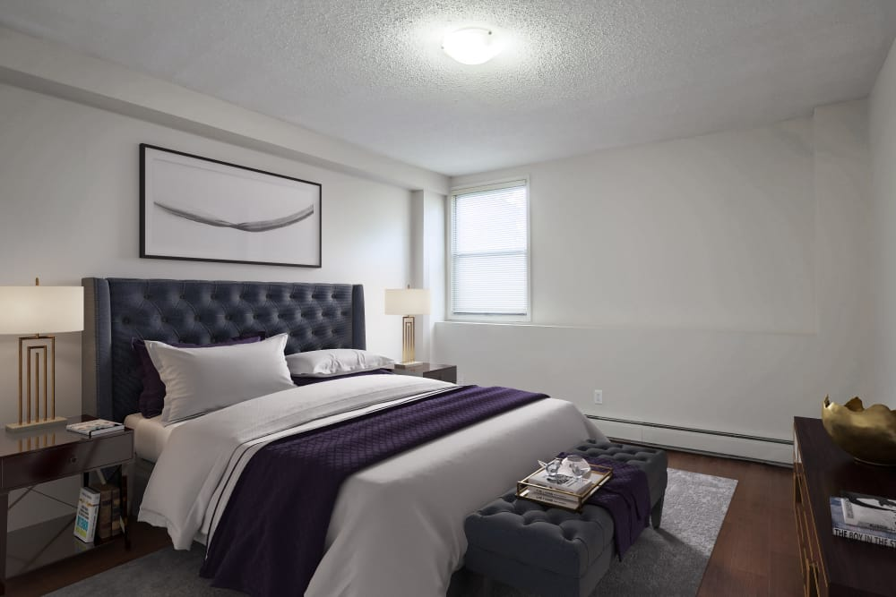 Bright and inviting bedroom at Lakeview Mews in Calgary, AB