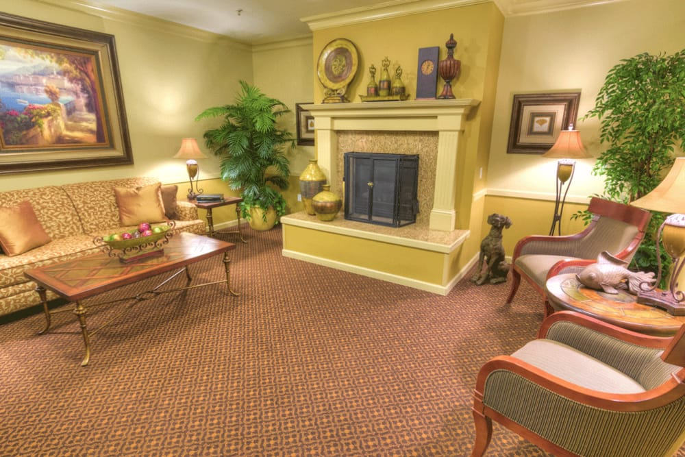 Curl up with a good book by the fireplace at The Meadows - Assisted Living