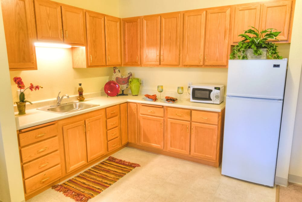 An apartment kitchen at The Meadows - Assisted Living