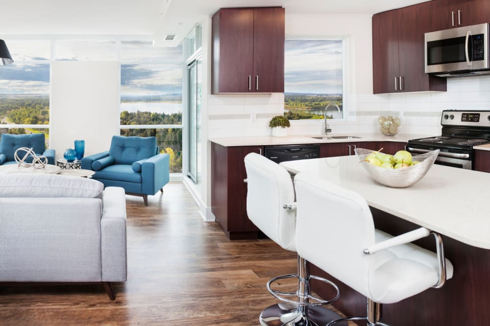 Elata offers a modern kitchen with breakfast bar in Calgary, Alberta
