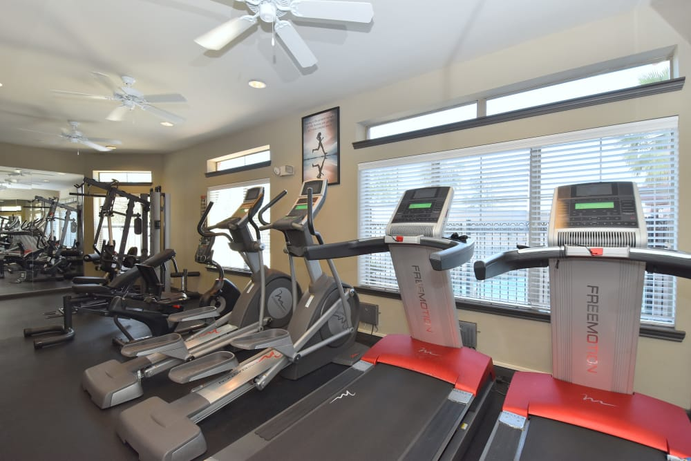Fully-equipped fitness center at Midtown Grove Apartments