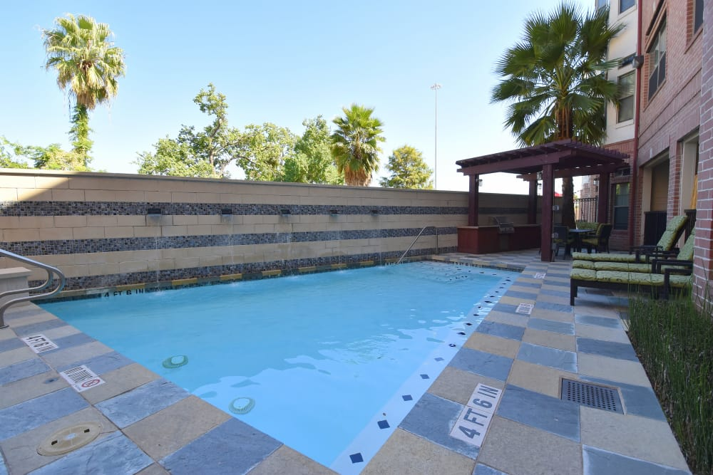 Covered sitting area by the Midtown Grove Apartments pool