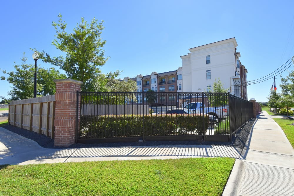 Fenced grounds at Midtown Grove Apartments