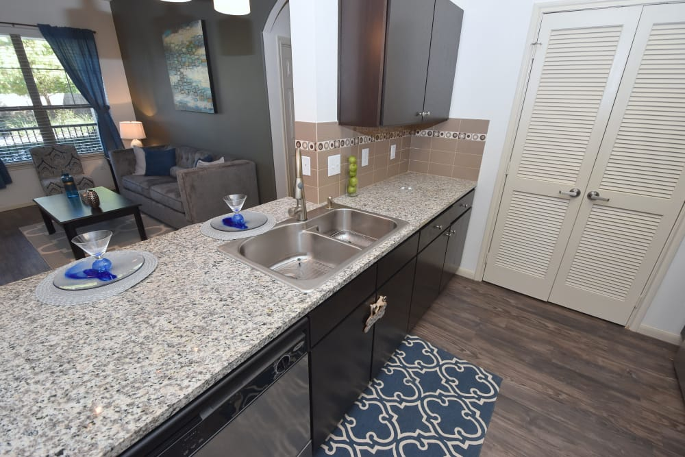 Kitchen with hardwood floors at Midtown Grove Apartments