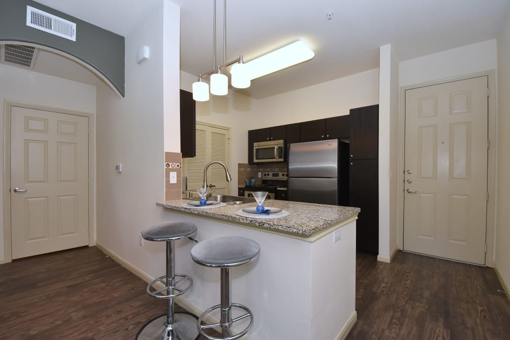 Midtown Grove Apartments kitchen with bar stools