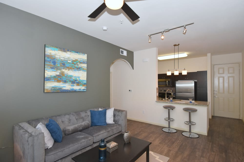 Living room with ceiling fan at Midtown Grove Apartments