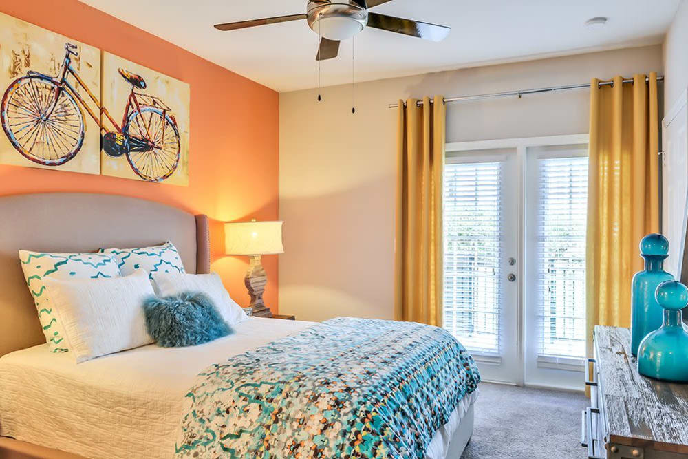 French doors and a ceiling fan in a bedroom at Parc at 980