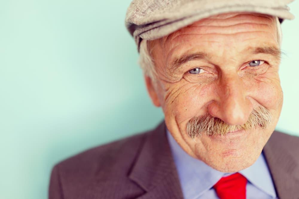 Senior with his hat on at MuirWoods Memory Care in Petaluma
