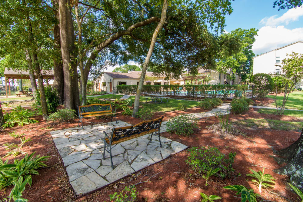 Shaded sitting area at Deerbrook Forest Apartments