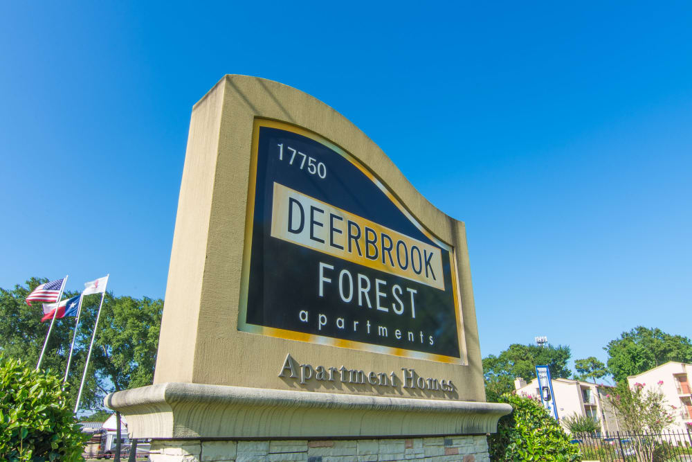 Welcome sign at Deerbrook Forest Apartments