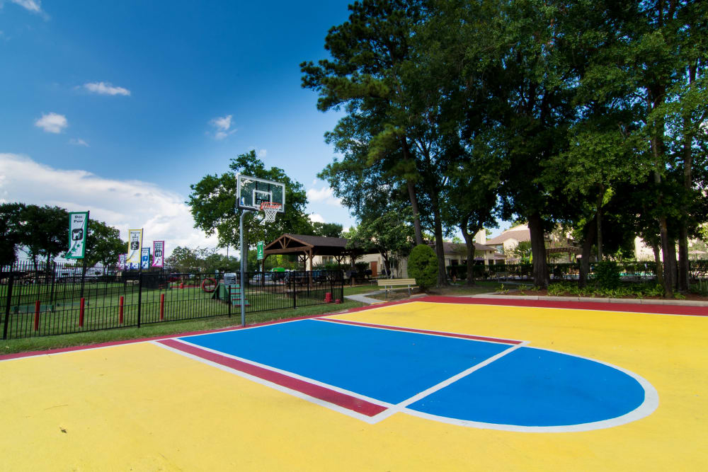 Multi-colored basketball court at Deerbrook Forest Apartments