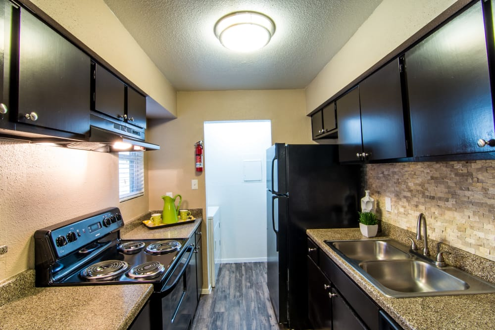 Deerbrook Forest Apartments kitchen with granite countertops