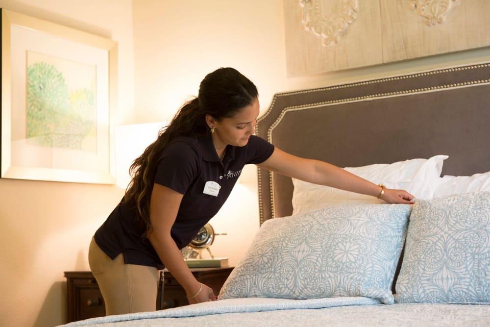 A maid making a bed in Bonita Springs