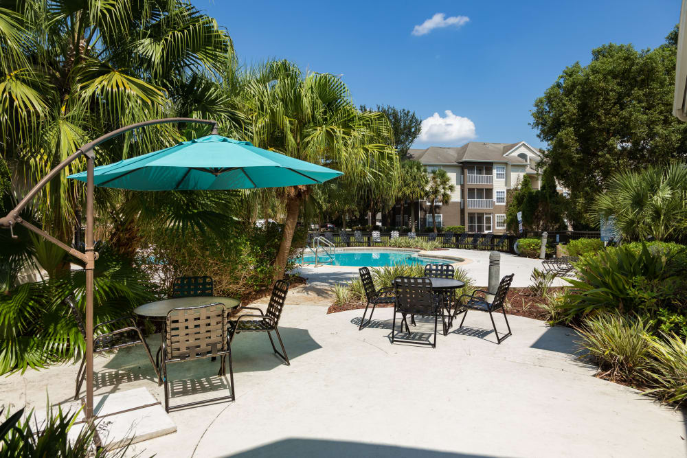 Comfortable shaded seating outside on a sunny day at Tuscany Villas of Brandon Apartment Homes