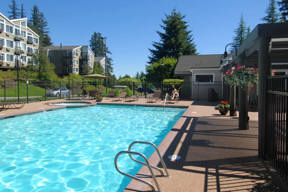 Relax by the pool at Sunset Summit Apartments in Portland, OR