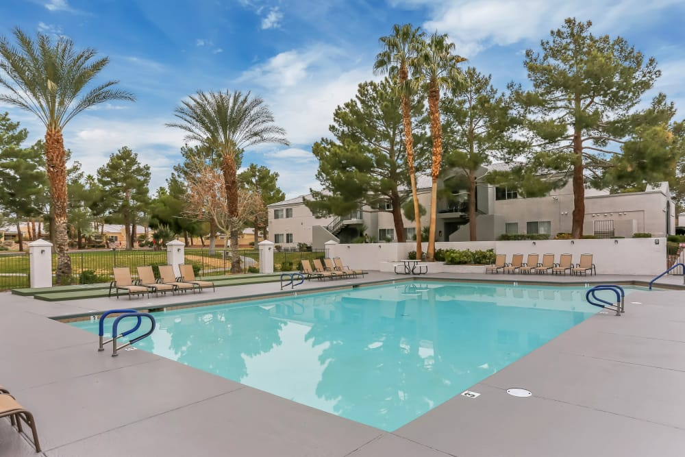 The pool area at Country Club at the Meadows includes an expansive sun deck and plenty of lounge chair seating for all.