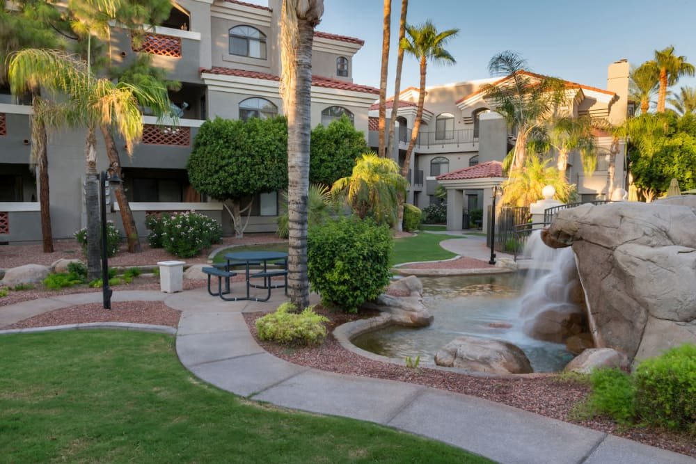 Palm trees and a waterfall compliment the San Marin at the Civic Center landscaping in Scottsdale, Arizona