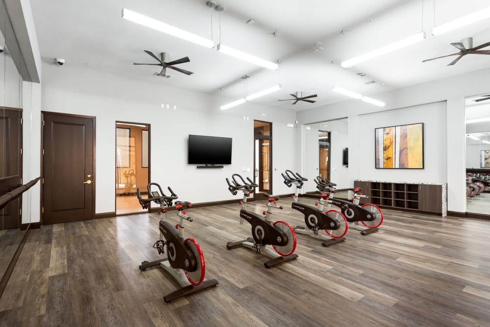 The fancy gym with stationary bikes at Villas at the Rim