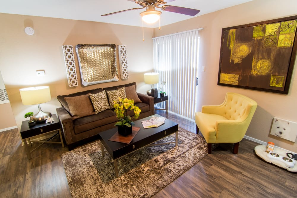 Living room with hardwood floors at Deerbrook Forest Apartments