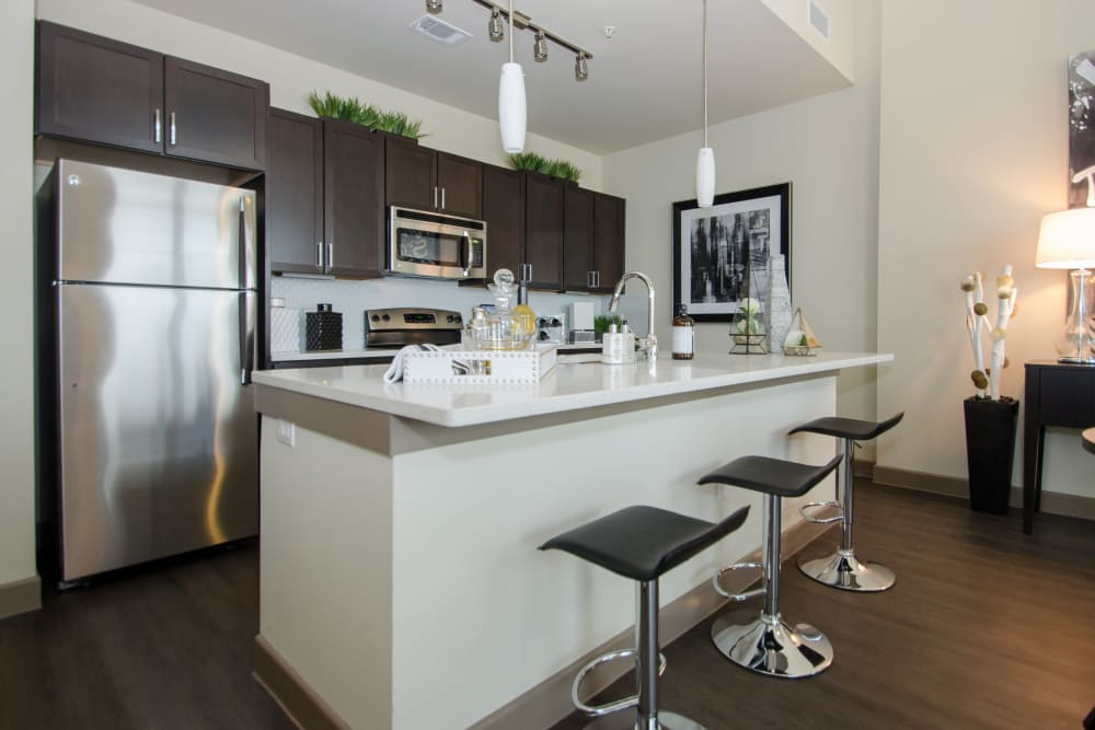 Kitchen bar at GreenVue Apartments in Richardson