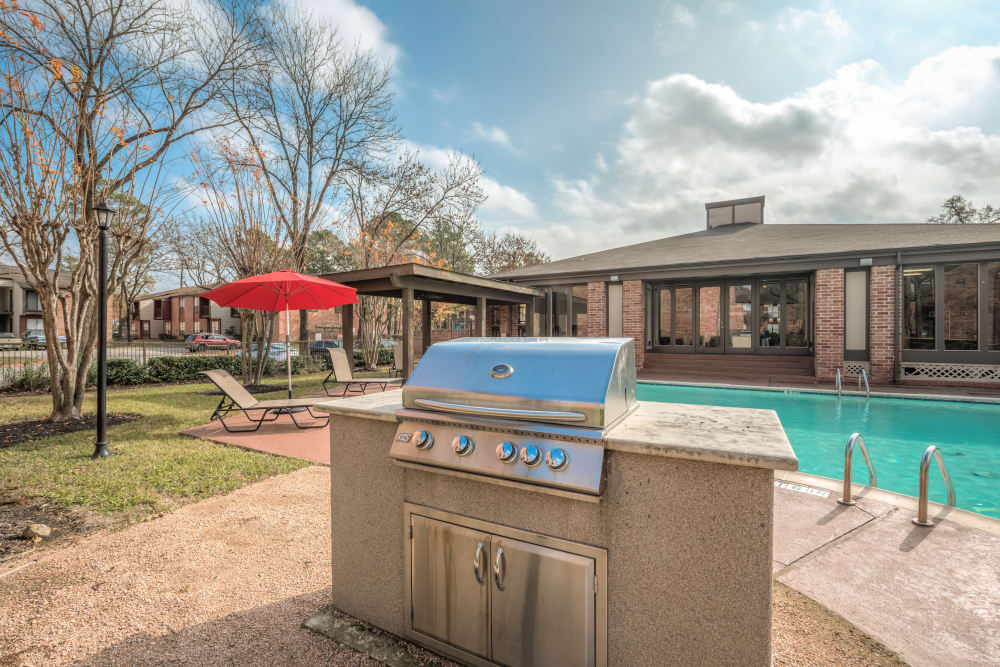 BBQ area near the pool at Rock Creek apartments in Houston, Texas