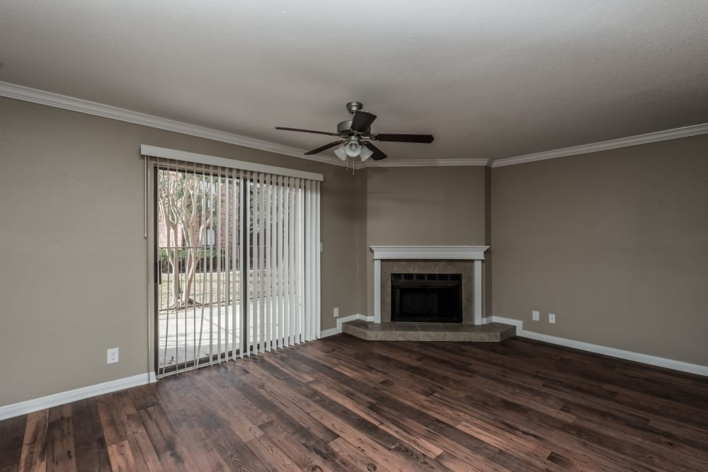Living room with fireplace at Rock Creek apartments