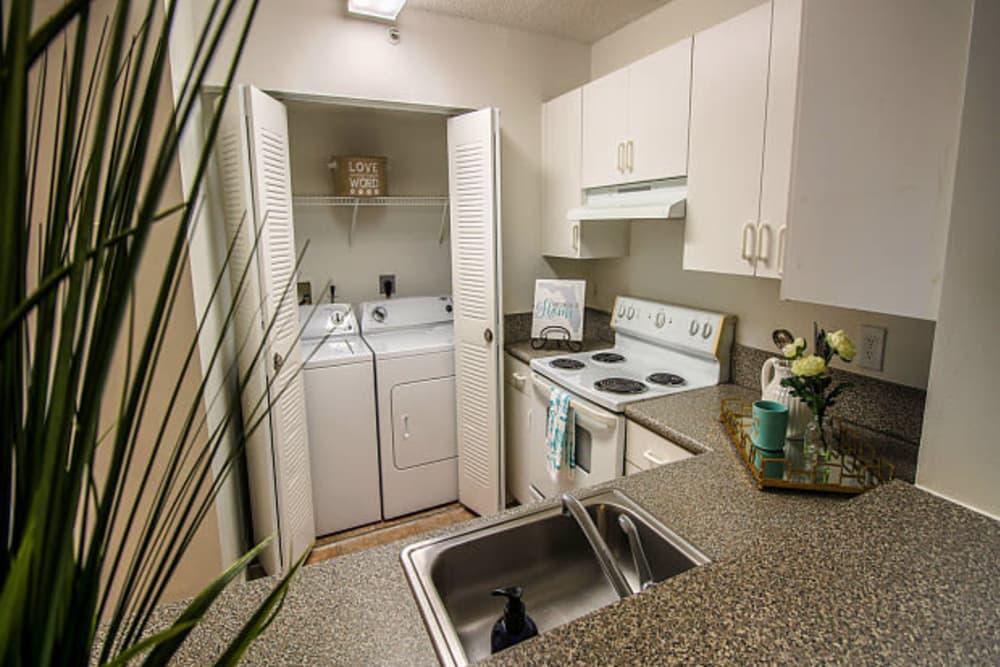 The kitchen and laundry room at Beach Walk at Sheridan