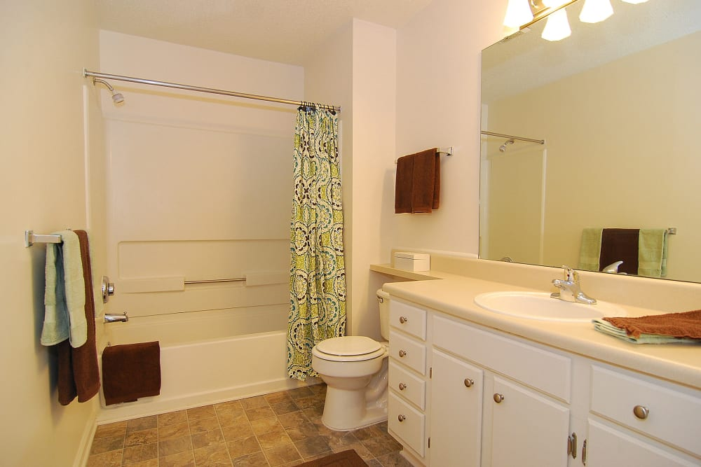 Spacious Bathrooms with Storage at Huntington Place Apartments in Columbia, SC