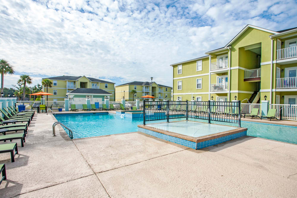 A swimming pool that is great for entertaining at apartments at Grand Biscayne in Biloxi, Mississippi